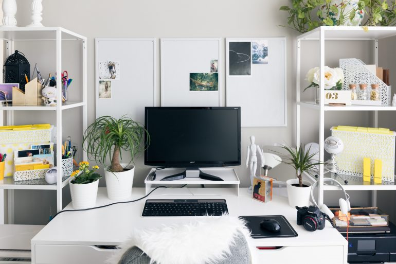 clean chic decorated work space with desktop computer
