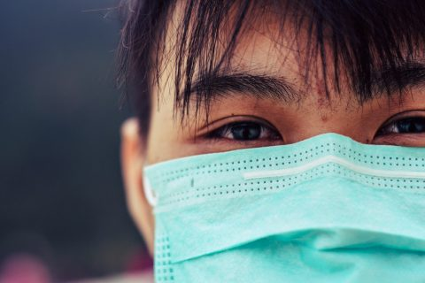 close up of asian male wearing doctor mask